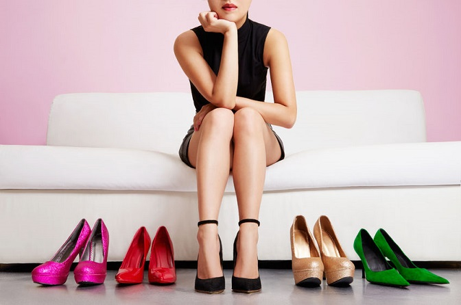 52756087 Woman Choosing Shoes Or Trouble With High Heels.